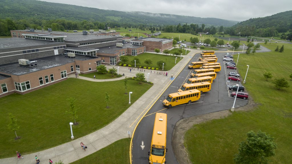 school buses are seen outside the building in an aerial photo